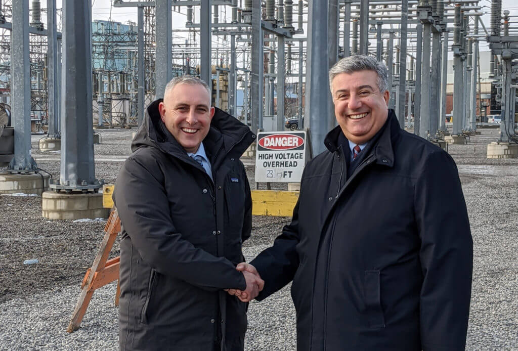 Hydro One and Alectra Shaking Hands